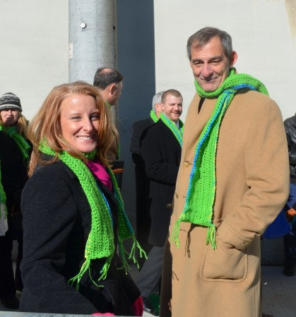 Livable Buckhead executive director Denise Starling, left, and Atlanta City Councilman Howard Shook donned green scarves for the ribbon cutting for PATH400 Jan. 9.