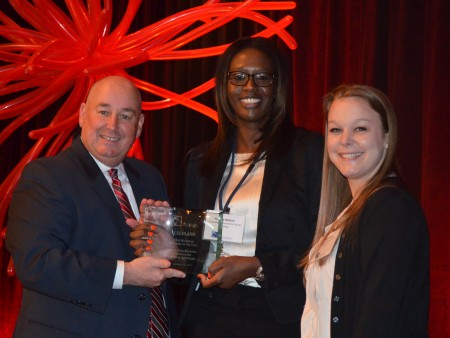 New BBA president Greg Davis, at left, presents Legoland general manager Penda Meftah, center, and marketing manager Whitney Wilson, at right, with the award fpr the organization's 'Business of the Year.' Davis presented the award during the BBA's annual luncheon on Jan. 22.