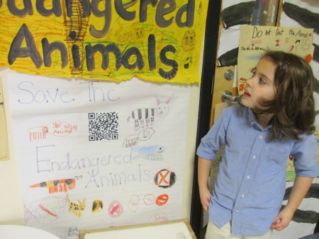 First-grader Mazie Emerson talks about her class' project that studied endangered animals. She said she learned about how 'some people destroy their habitats and how they can save them.'