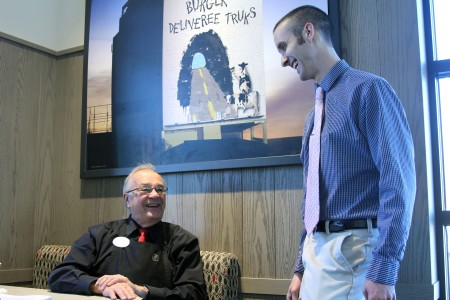 Gene Vezina, left, and Mark Bartolucci chat at Gene's workplace, the Chick-fil-A.
