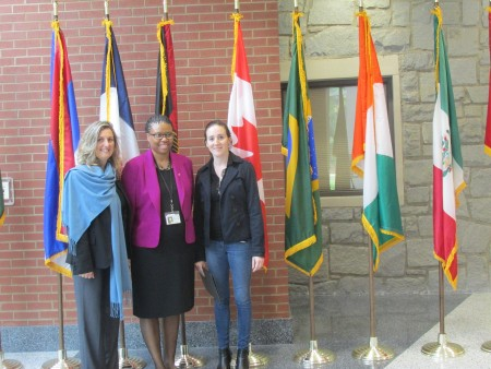 Dr. Shamita Johnson (center) poses with a principal and teacher from Sutton's sister school in France.