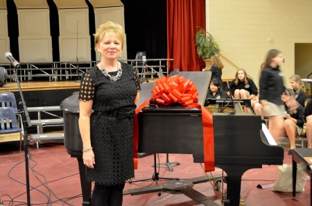 Dr. Susan Messer shows off the music department's new grand piano.