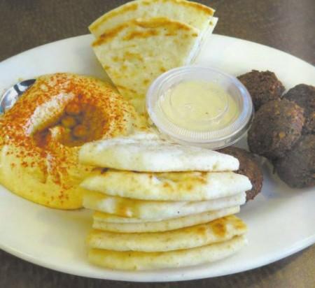 A starter plate of hummus and Falafel at Café Sababa.