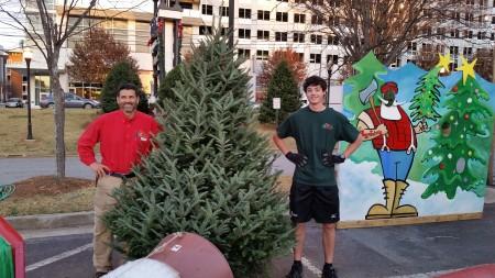 John Livaditis, right, handles tree removal for Big John's Christmas Trees.