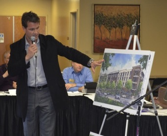 Kirk Demetrops shows members of the Sandy Springs Planning Commission renderings of proposed designs for a mixed-use development on Roswell Road.