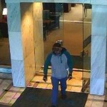 Dunwoody Police seek the man pictured in connection with w Feb. 19 bank robbery.