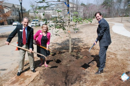 Council members Joe Gebbia, left, Rebecca Chase Williams and Bates Mattison help transplant a tree at Brookhaven's Arbor Day celebration.
