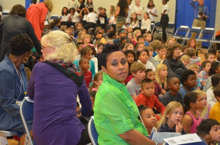 Kindergarten teachers Rachel Lightfoot, right, and Nancy Sears keep an eye on their students at the ribbon-cutting ceremony for the newly remodeled E. Rivers Elementary School.