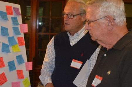 Vic Cavanaugh, left, and Walt Lambeth review comments posted on plans for the Bobby Jones Golf Course.