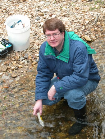 Volunteer David Fountain uses a meter to measure the electrical conductivity of Long Island Creek, part of his stream monitoring duties for Georgia Adopt-A-Stream.  Fountain conductivity.jpg - Sandy Springs resident David Fountain uses a meter to measure electrical conductivity of Long Island Creek as part of his stream monitoring duties as a volunteer for Georgia Adopt-A-Stream. November marked his 20th year of monitoring the creek for the organization, and he says he has no plans to stop his efforts. Fountain monitoring.jpg - David Fountain kneels next to his stream monitoring equipment, which he uses to monitor conditions at Long Island Creek near his Sandy Springs home. This past March, Georgia Adopt-A-Stream recognized Fountain's 20-plus years of stream monitoring by giving him its Excellence in Data Collection award. Fountain closeup.jpg  - maybe just for headshot if you need it?
