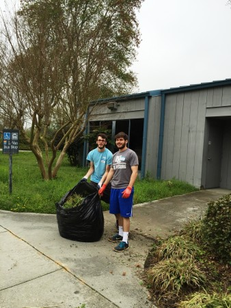 Curtis Poretsky and William Joseph Skillas  of Chamblee Charter High School do some landscaping work at the DeKalb Service Center.