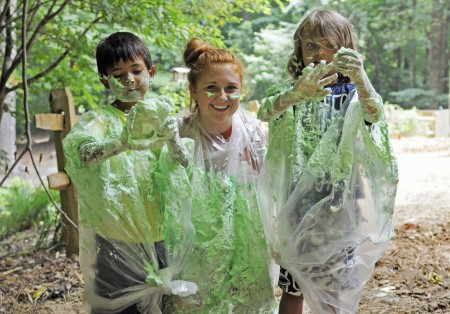 Dunwoody Nature Center Junior Counselor Kacie Lowrey, center, and campers Smith Ellis, left, and Christian Chaves, right, show off results from their shaving cream experiment.