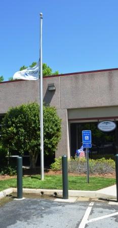 Sandy Springs' city flag flies at half staff to honor the memory of former Mayor Eva Galambos, who died April 19.