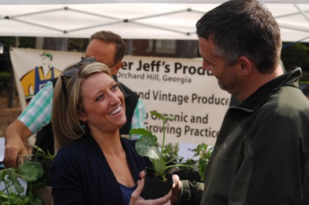 Whitney Cook, left, and Brandon Webb shop for plants at the Peachtree Road Farmers Market on opening day last year.