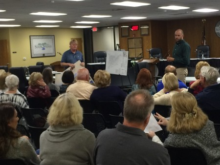 Clif Poston, of Traton Homes, and Kevin Howard, city planner, answer questions April 28 from community members about a proposed townhome development in Spalding Woods.