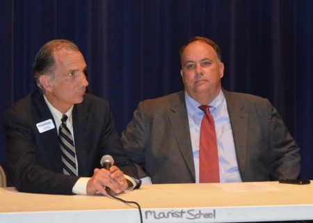 """Brookhaven City Councilman Joe Gebbi, left, and Mayor J. Max Davis field questions from residents during a """"town hall' meeting May 28 at the Marist School."""