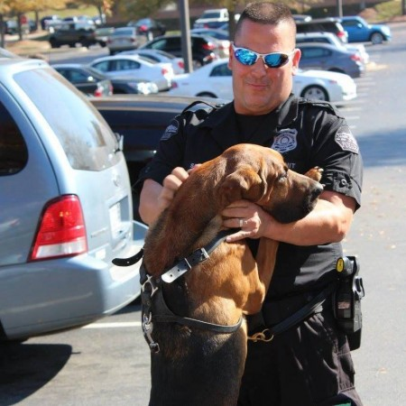 Sandy Springs K9 Seven and his handler, Officer Mike Stark, celebrate the donation of a protective vest for the K9.