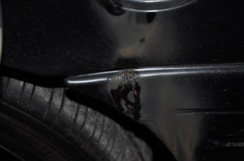 Damage sustained to the gas cap of a Sandy Springs police car on June 29.
