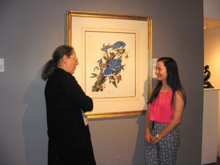 Anne McCallum, left, a member of the Atlanta Audubon Society who volunteered to be a docent at the Oglethorpe University Museum of Art, discusses a bird print with Jessica Gregerson, an Oglethorpe student who is also a new docent.