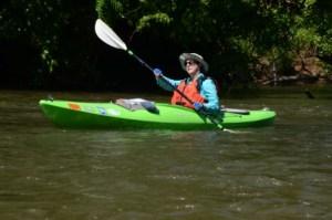 Ellen Cardin paddling her kayak on the Etowah River.