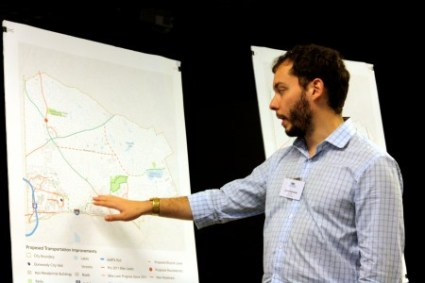 Jason Novsam, a transportation planner for Jacobs Engineering, on June 30 shows residents the changes between the 2011 and the current transportation plans in Dunwoody.