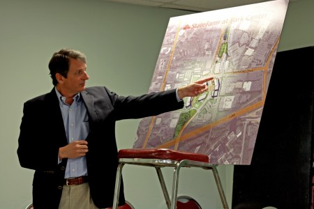 Alex Chambers points out designs for State Farm's corporate campus.
