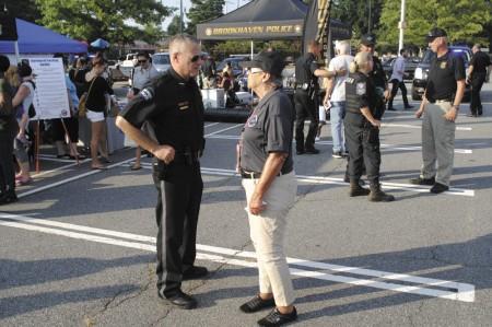 Sandy Springs Citizen Patrol Officer Joan Pressman (right) speaks with Sandy Springs Police Chief Kenneth DeSimone (left).