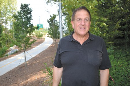 Robert Sarkissian, who lives next door to the new park at 519 Old Ivy, says the green space is needed.
