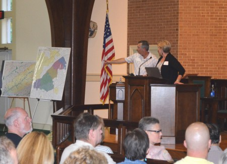 LaVista Hills Alliance representatives Matt Slappey, left, and Mary Kay Woodworth address the crowd gathered at Briarcliff United Methodist Church to hear arguments for the proposed city.
