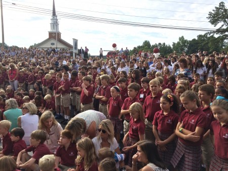 Hundreds of students and supporters watch the formal opening and blessing of he new Holy Innocents Episcopal School math, science and commons building.