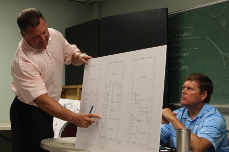 Lonnie Moss, with Cypress Communities, on Aug. 2 describes the changes to a plan for townhomes in the Dunwoody Village area as DHA board member Joe Tuttle looks on.