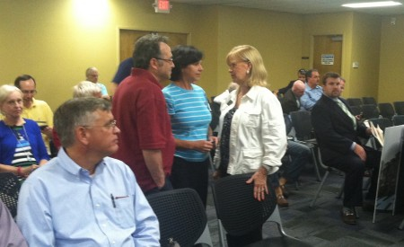 Brookhaven Mayor Rebecca Chase Williams (right) talks with residents before the Sept. 17 Sandy Springs Planning Commission meeting about the Pill Hill apartments.
