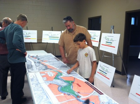 Residents examine a map of the Peachtree Creek Greenway at Brookhaven area and potential trail paths at the Oct. 22 meeting at Briarwood Park.