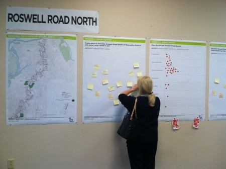 A resident writes a comment about the current state of northern Roswell Road at the Oct. 14 open studio.