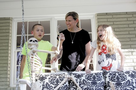 Buckhead residents Marsha Sims, center, with two of her children, Jack Schramkowski, left, and Olivia Schramkowski, decorate their yard for Halloween. They also take advantage of a Varsity food truck that parks in their neighborhood during the evening of Oct. 31.
