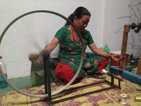 A woman weaving in Pokhara, Nepal, at the Women's Skills Development Organization.