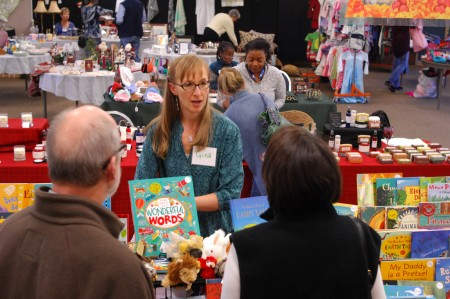 Gina Gallois sells children's books at Barefoot Books. (Photo by Phil Mosier)