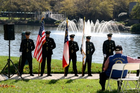 Sandy Springs Police Department Honor Guard: Sgt. Hyon yi, Lemmie Shorts, Kevin Smith, Nicholas Trujillo and Kyle Bettis present the colors during the Sixth Annual Veterans Day Tribute at Concourse Nov. 11. Photo by Ellen Eldridge.
