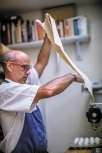 Chef Jamie Adams at Il Giallo makes hand-made pasta.