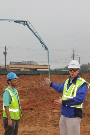 City Manager John McDonough (right) gestures to the performing arts center construction area at City Springs on Dec. 11 as Holder Construction project manager Hayes Todd looks on. (Photo: John Ruch)