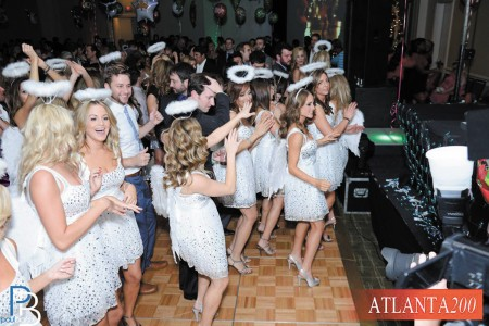 Angels dancing at a Jingle Mingle charity event hosted annually by Atlanta Two Hundred.