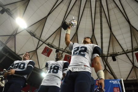 Pace Knights players hoist the AA championship trophy in the Georgia Dome after beating Fitzgerald High Dec. 12. (Special)