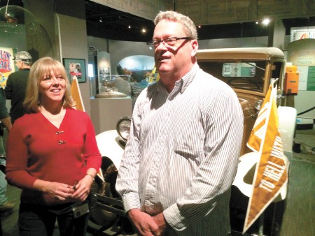 """Amy Wilson and Don Rooney with Georgia Tech's """"Rambling Wreck,"""" a part of the Atlanta History Center's """"Atlanta in 50 objects"""" exhibit."""