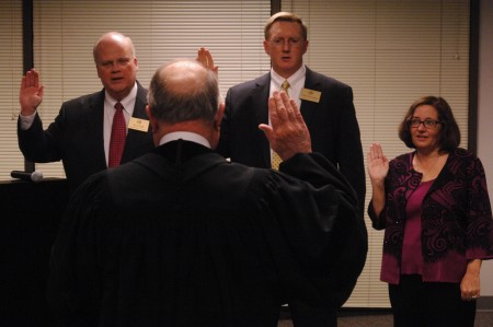 Members of Dunwoody City Council are sworn in for new terms on Jan. 4. Left to right, Councilmembers Terry Nall, John Heneghan and Lynn Deutsch take the oath of office.