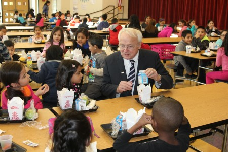 Kevin Concannon, under secretary for food, nutrition and consumer services at the U.S. Department of Agriculture, eats lunch with students at Lake Forest Elementary School in Sandy Springs on Jan. 12. (Photo John Ruch)