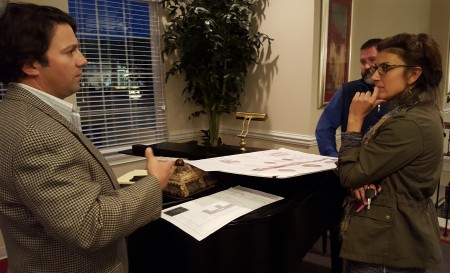 Joe Dan Rogers (left), chief development officer at Mansions Senior Living, discusses the proposed Spalding Drive assisted living facility with local resident Michelle Merrill at the Feb. 9 meeting. (Photo John Ruch)