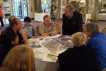 """Consultant Elliot Rhodeside (standing) leads one group of residents in discussion at the March 28 """"Next Ten"""" meeting about the MARTA station plans at Sandy Springs' Sherwood Event Hall. (Photo John Ruch)"""
