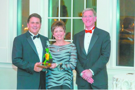 Bruce and Sally Alterman, left and center, of The Brickery received the Restaurant of the Year Award from Sandy Springs/Perimeter Chamber of Commerce Board Chair Lever Stewart, right.