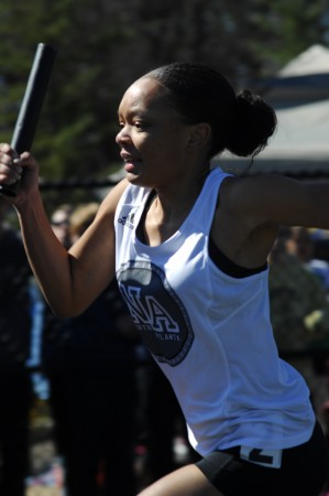 North Atlanta High School senior Tanashia Trice sets out on her leg of the 4 x 100 meter relay.