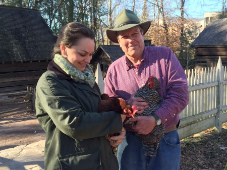 Atlanta History Center employees Sara Roberts and Brett Bannor show off some of the chickens who live on campus at the Smith Family Farm. (Special)